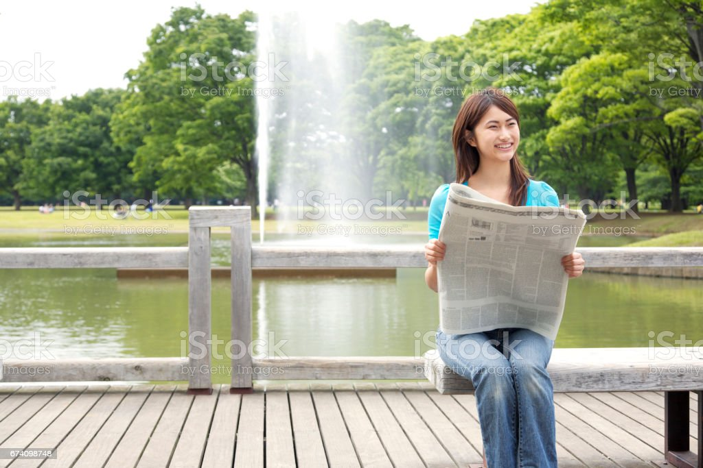 Women reading newspaper royalty-free stock photo