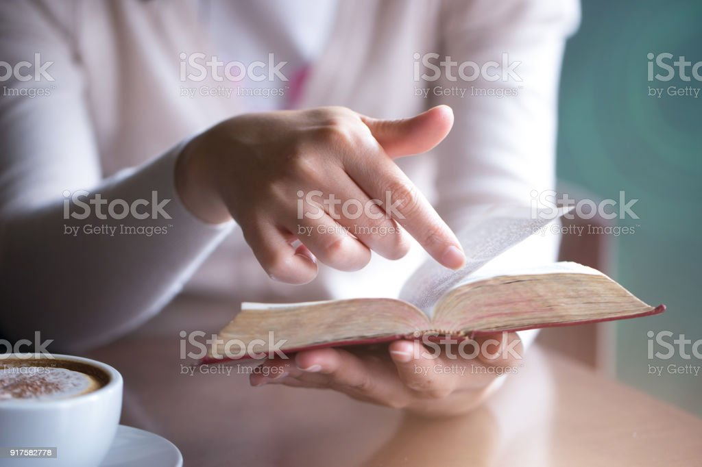Women reading the Holy Bible.,Reading a book. stock photo
