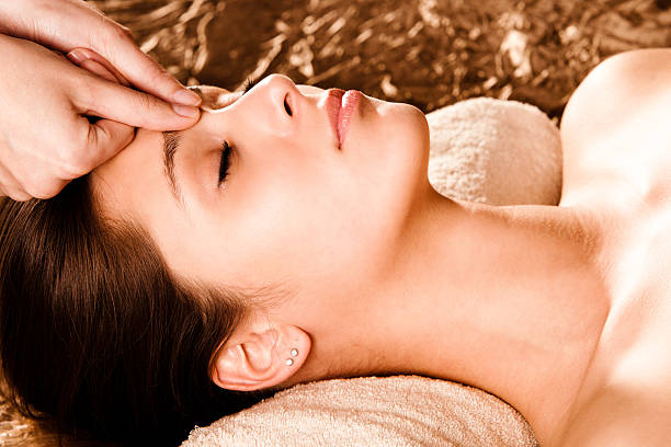 Women receiving a facial massage stock photo