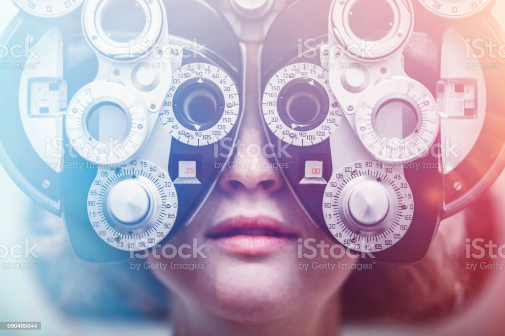 Women Receiving Eye Exam stock photo