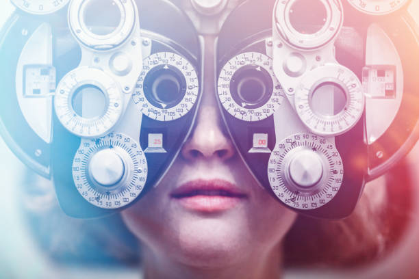 women receiving eye exam - optometrist stock pictures, royalty-free photos & images