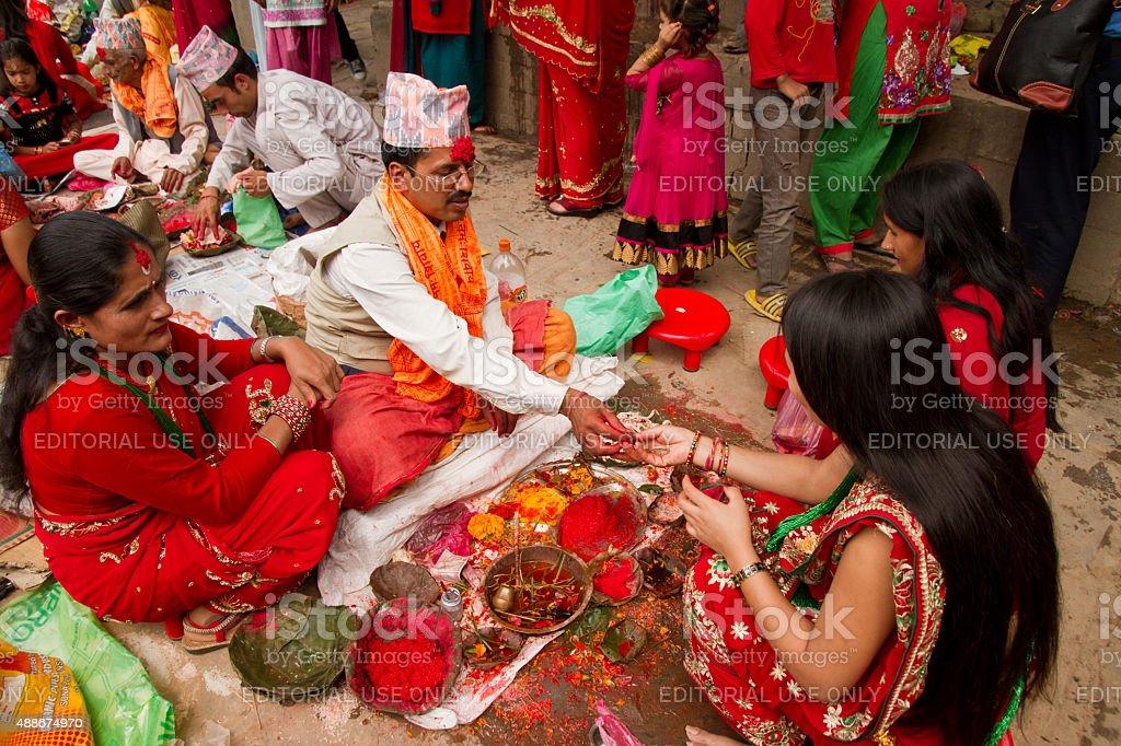Women recieve blessings at Teej festival, Durbar Square, Kathman stock photo