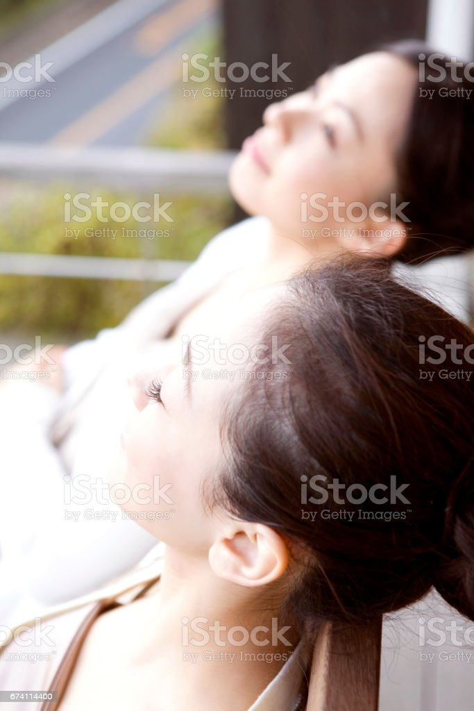 Women recline in the Chair royalty-free stock photo