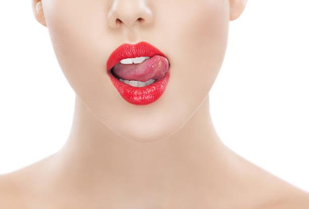 frauen rote lippen mit lasche aus dem mund - marko skrbic stock-fotos und bilder