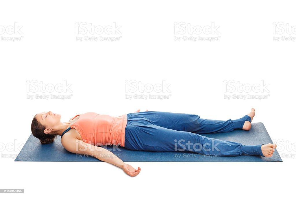 Women relaxes in yoga asana Savasana stock photo
