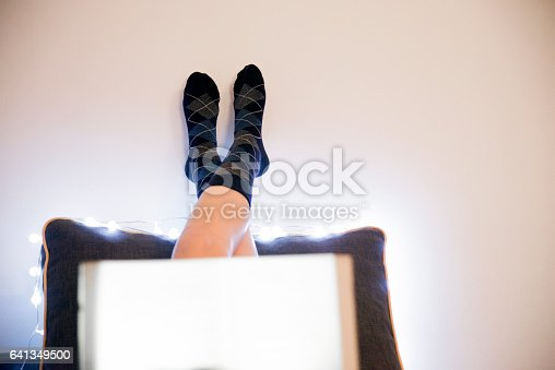 501914364istockphoto Women relaxing in bed and reading a book 641349500