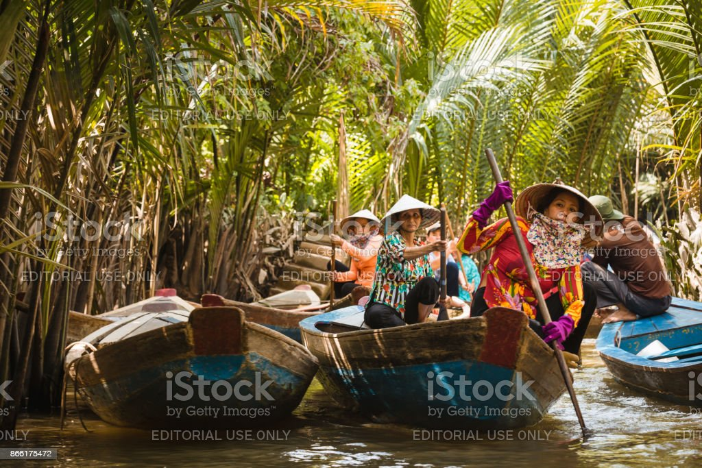 Women rowing a boat at the Mekong river stock photo