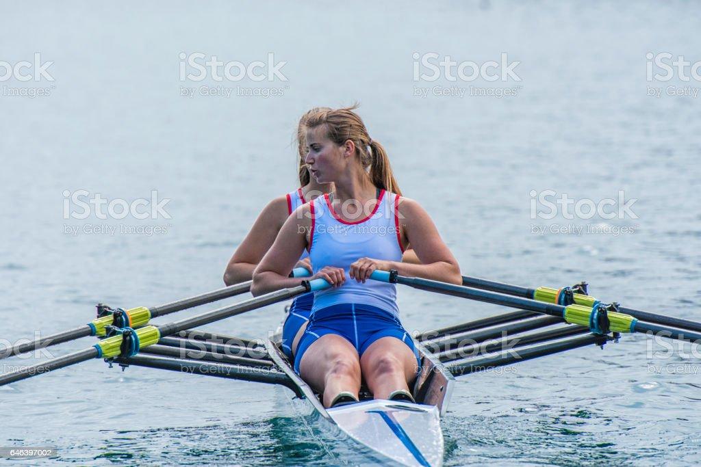 Women rowing boat stock photo