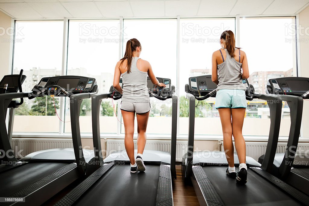 Women run at the fitness club royalty-free stock photo