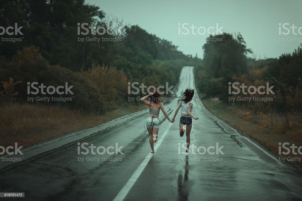 Women run on the road. stock photo