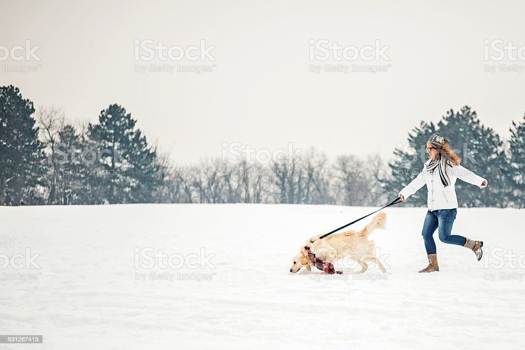 Women run with her dog stock photo
