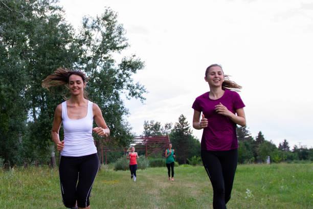 Women running along the forest stock photo