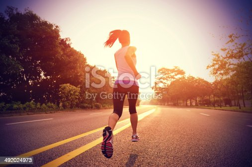 istock Women running on road in early morning 492024973