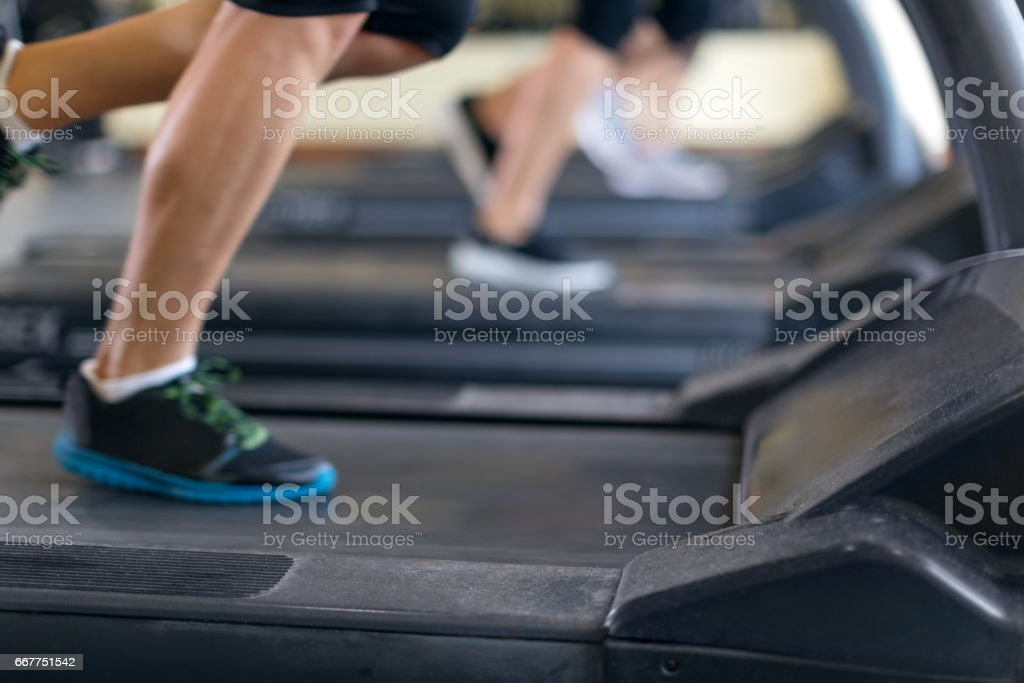 Women running on tread mill stock photo