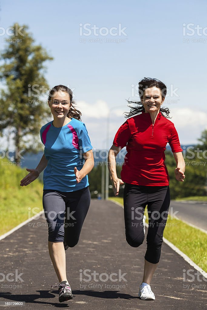 Women running outdoor royalty-free stock photo