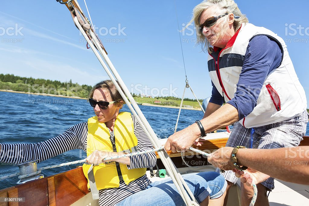 Women Sailing and Coming About stock photo