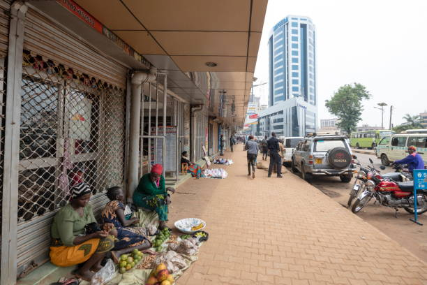 Women sell fruits and vegetables at a street of Kampala, Uganda. stock photo