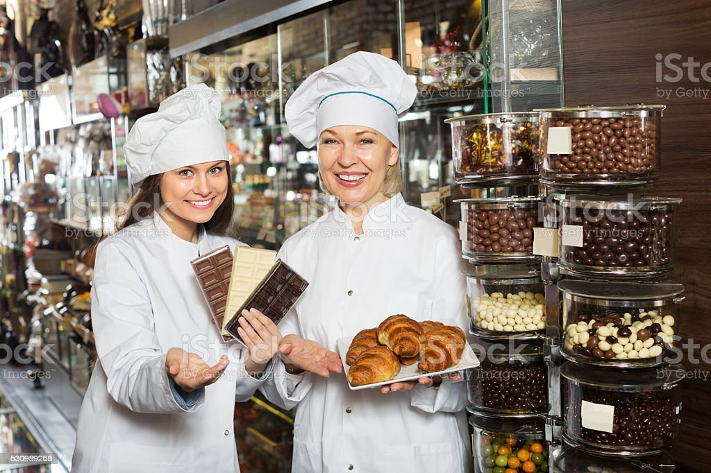 Women selling fine chocolates stock photo