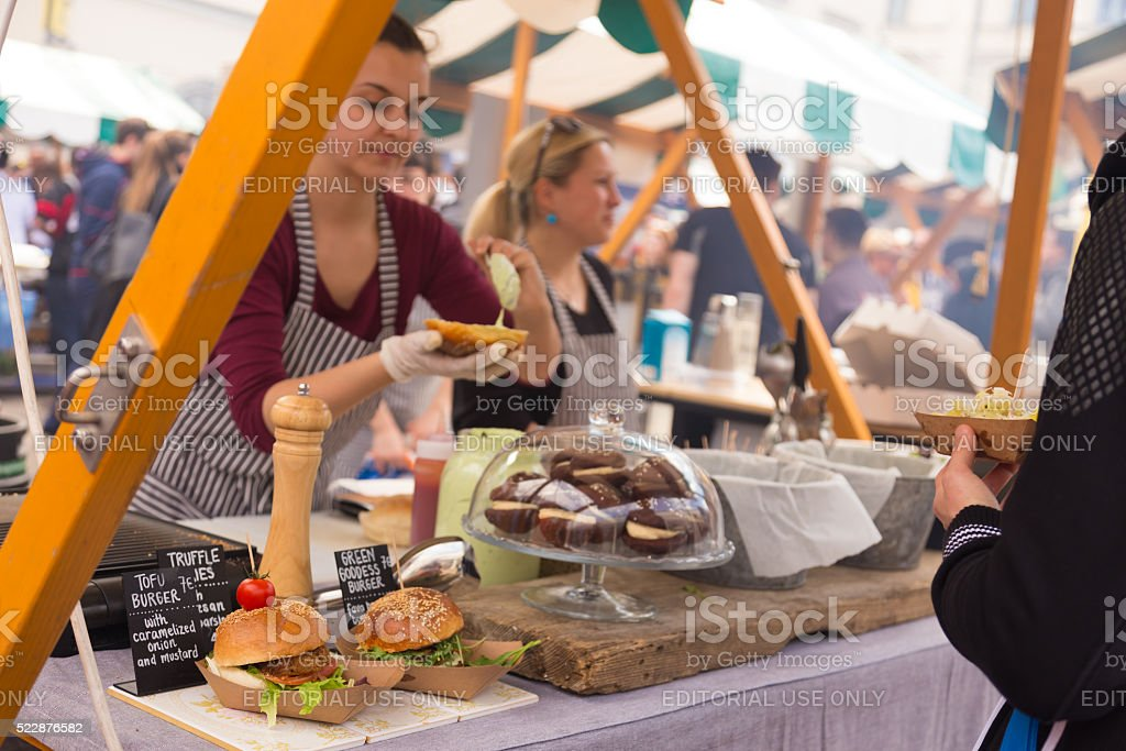 Women serving hamburgers on food festival in Ljubljana, Slovenia. stock photo