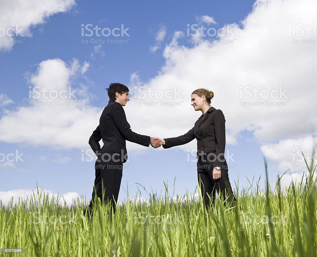Women shaking hands outdoor in nature royalty-free stock photo