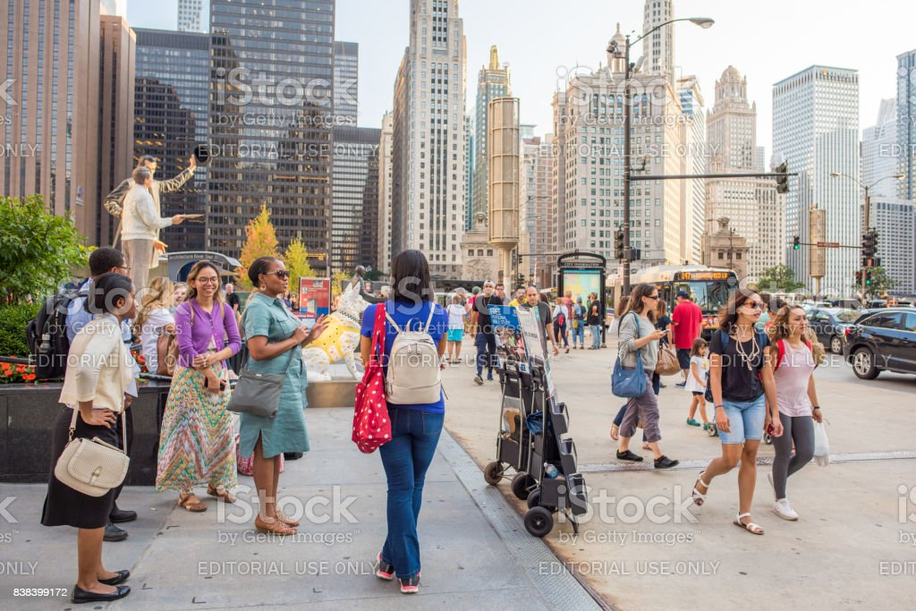 Women sharing Bible literature downtown Chicago stock photo
