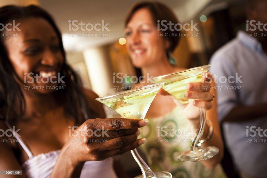 Women sharing drinks at a bar stock photo