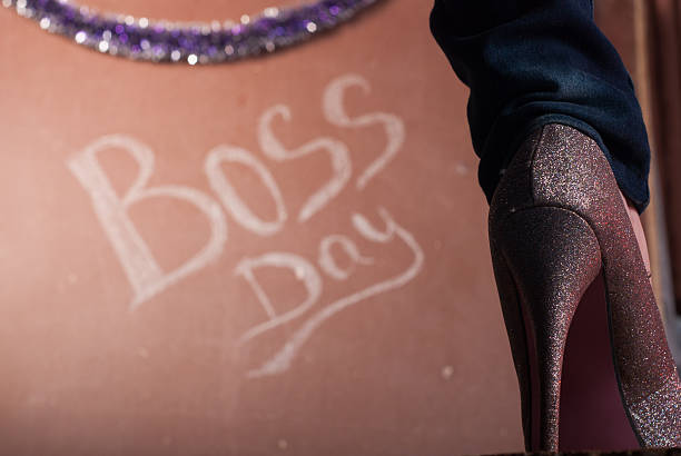 Women shoes with crystals closeup Women shoes with crystals closeup ,of the inscription chalk on the background, boss's day, the concept of a business woman, a business shark boss's day stock pictures, royalty-free photos & images