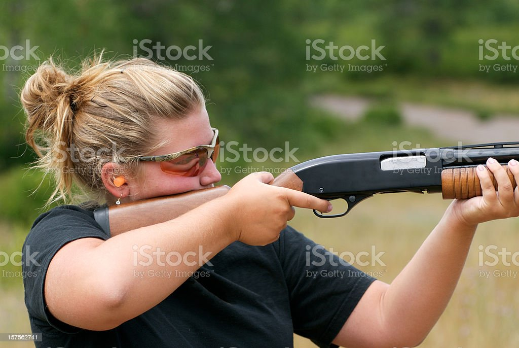 Women shooting shotgun stock photo