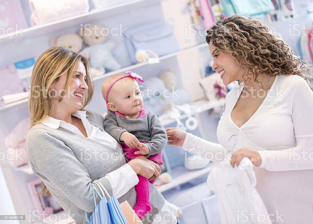 Women shopping at a baby shop stock photo