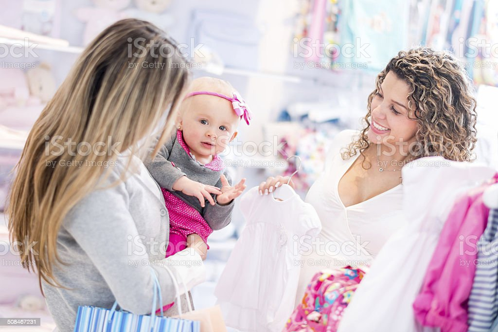Women shopping at a baby store stock photo