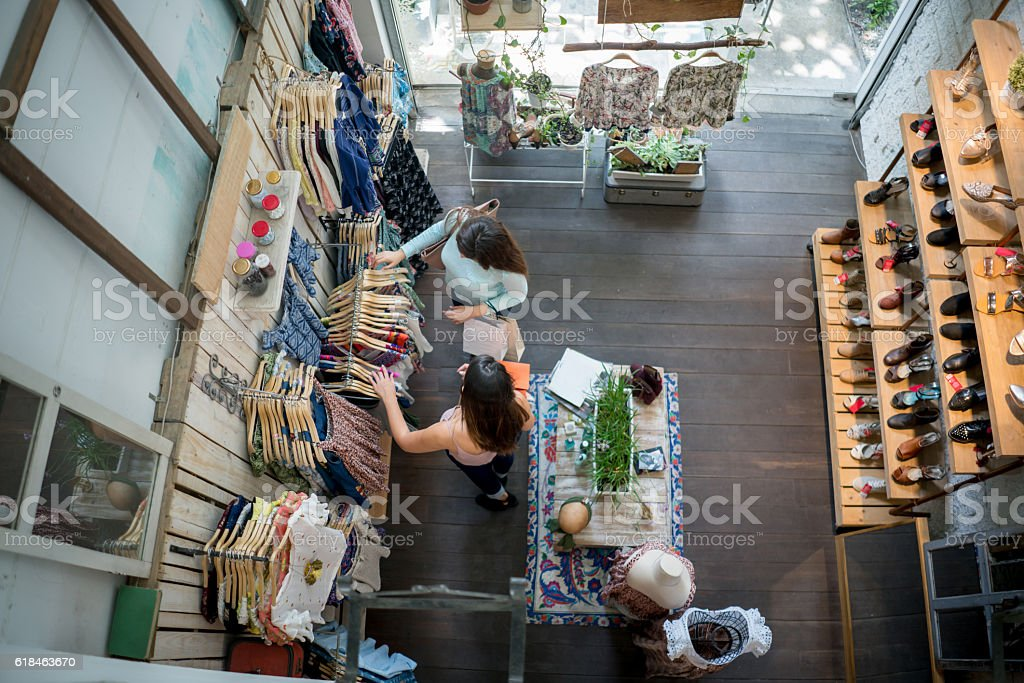 Women shopping at a clothing store stock photo