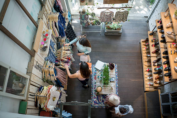 Women shopping at a clothing store ストックフォト