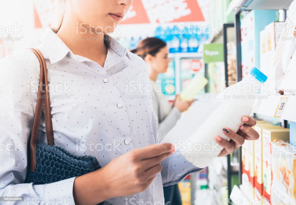 Women shopping at the supermarket stock photo