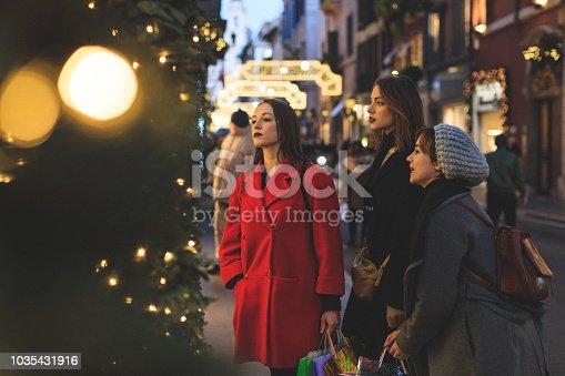 Women shopping during winter christmas sales in Piazza di Spagna and Via dei Condotti in Rome, Italy