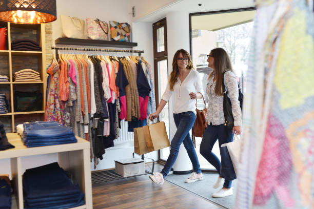 Women shopping in a fashion boutique stock photo