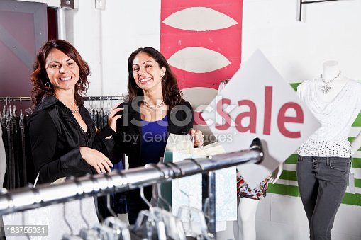 Mid adult women shopping in clothing store
