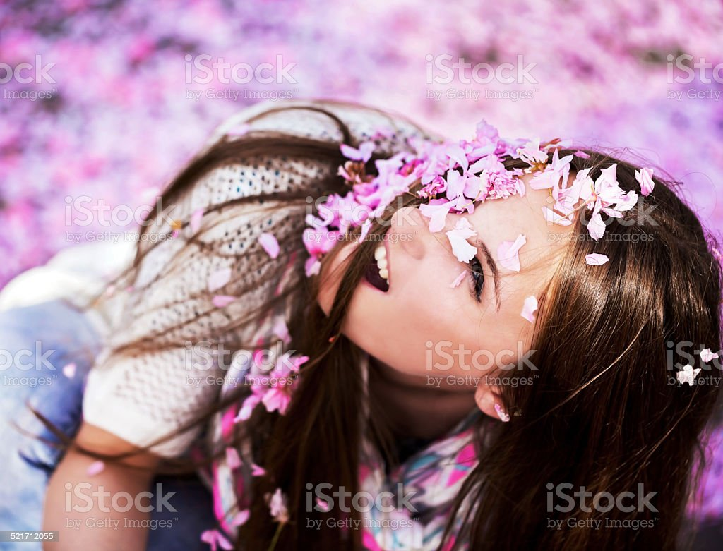 Women showered with pink petals stock photo