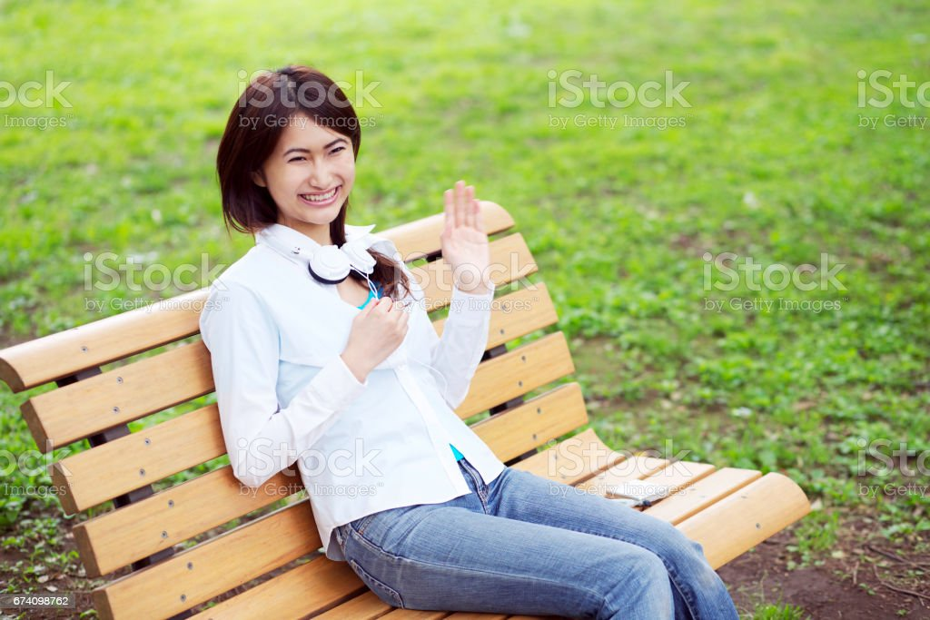 Women sit on a bench royalty-free stock photo