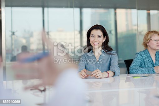 istock Women sitting at conference table in bright office 637940968