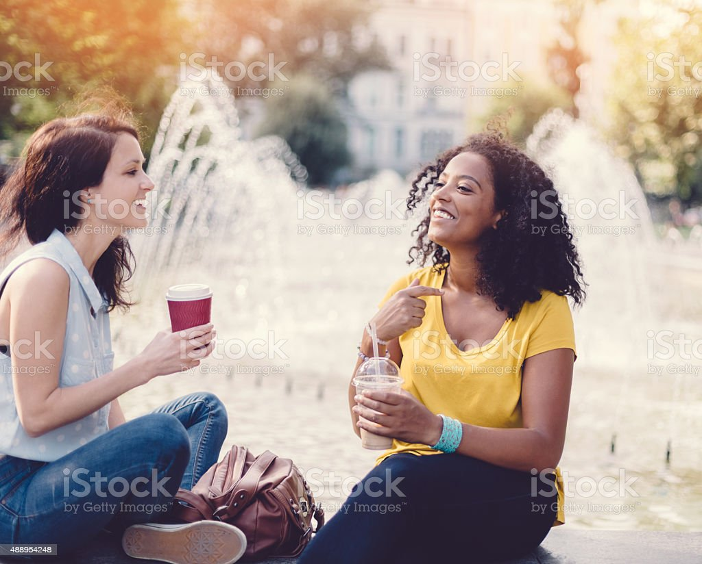 Women sitting at the fountain stock photo