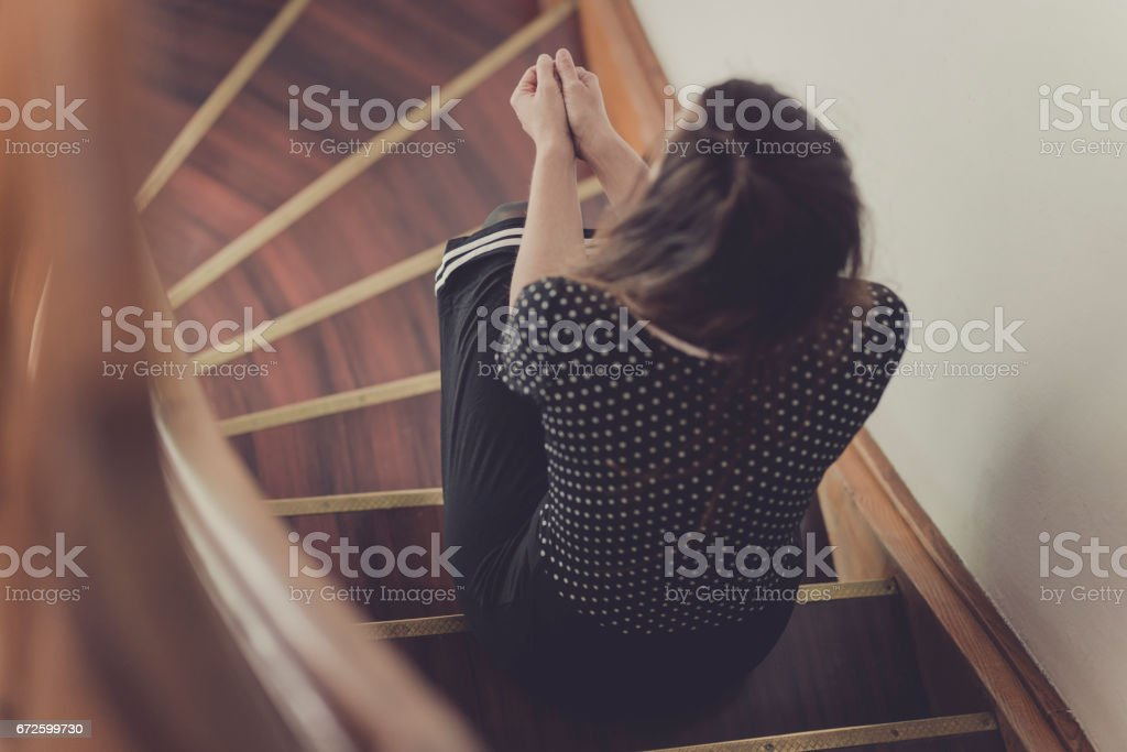 women sitting on staircase stock photo