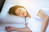 istock Women sleeping on the bed and grinding teeth,Female tiredness and stress 1051229294