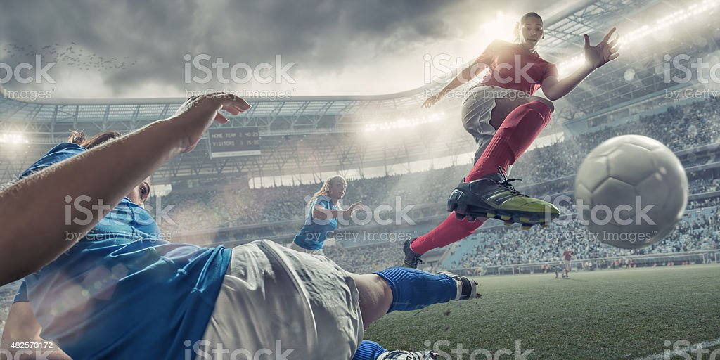 Women Soccer Players In Mid Air Action stock photo