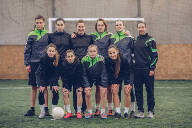 women soccer players - sports uniform stock photos and pictures