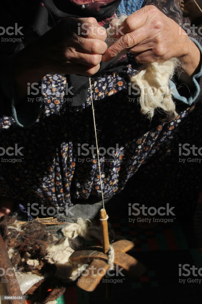 Women spinning wool stock photo