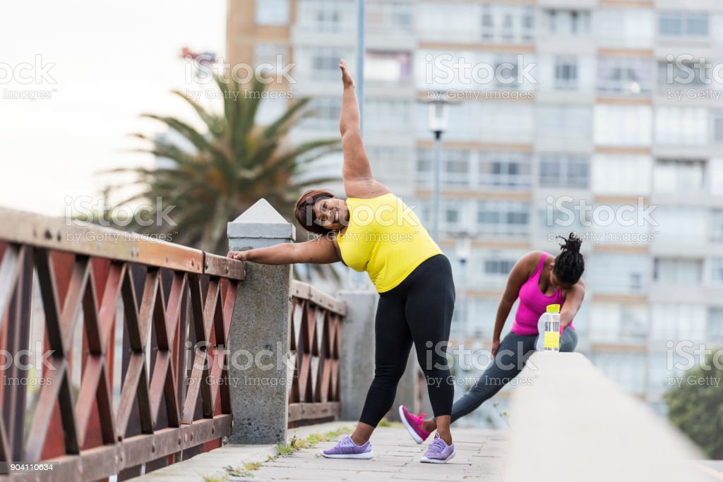 Women stretching and getting ready for morning run stock photo
