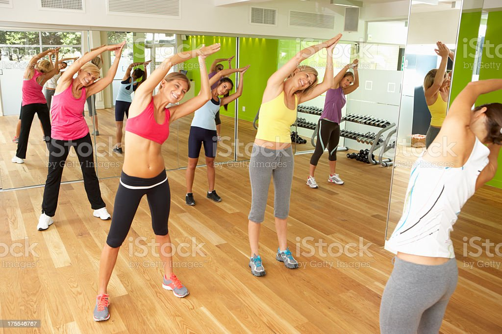 Women stretching in a group fitness class stock photo
