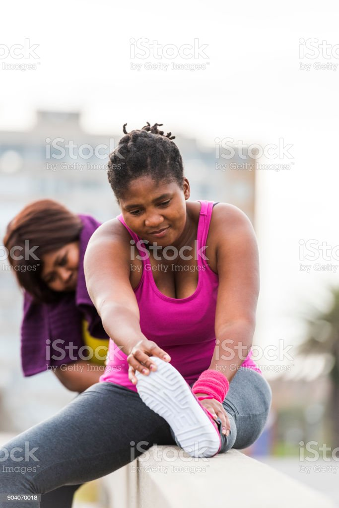 Women stretching to warm down stock photo