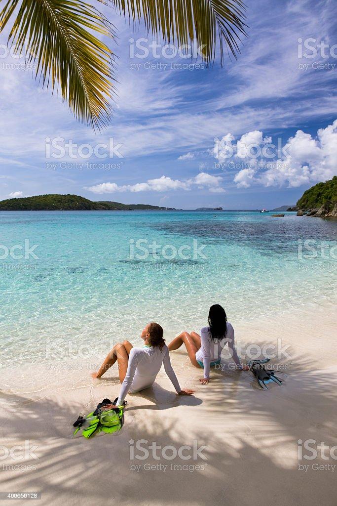 women sunbathing on a beach after snorkeling in St.John, USVI stock photo