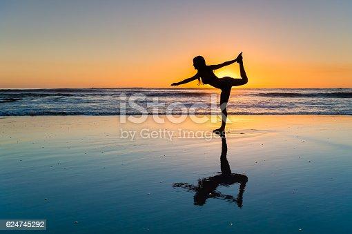 istock Women Sunset Yoga 624745292